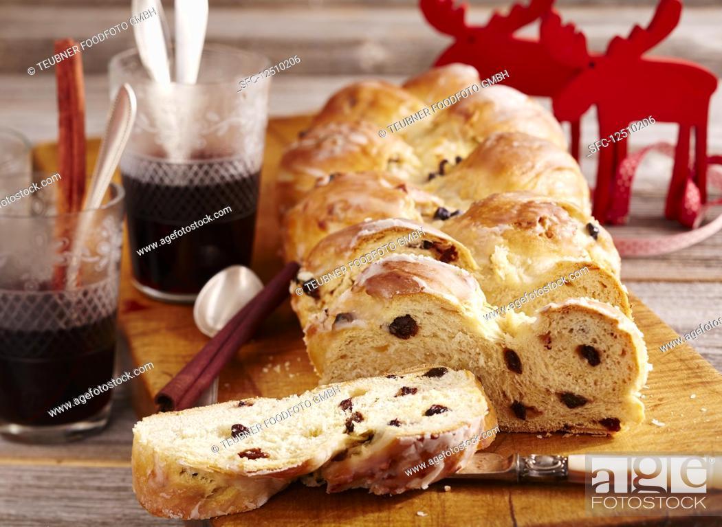 Stock Photo: Raisin bread plait with icing (Christmas).