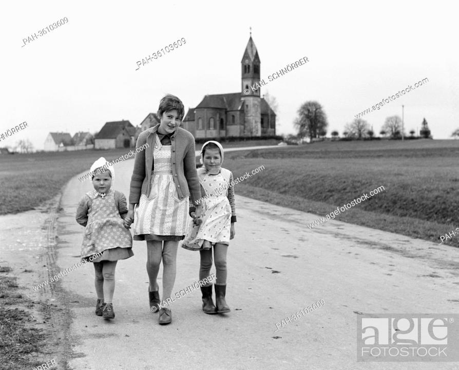 Stock Photo: Thirteen-year-old cardiac Irene Walter (M) goes for a walk with her two sisters Gabriele (l) and Bernadette (r) on the 12th of November in 1963 in their.