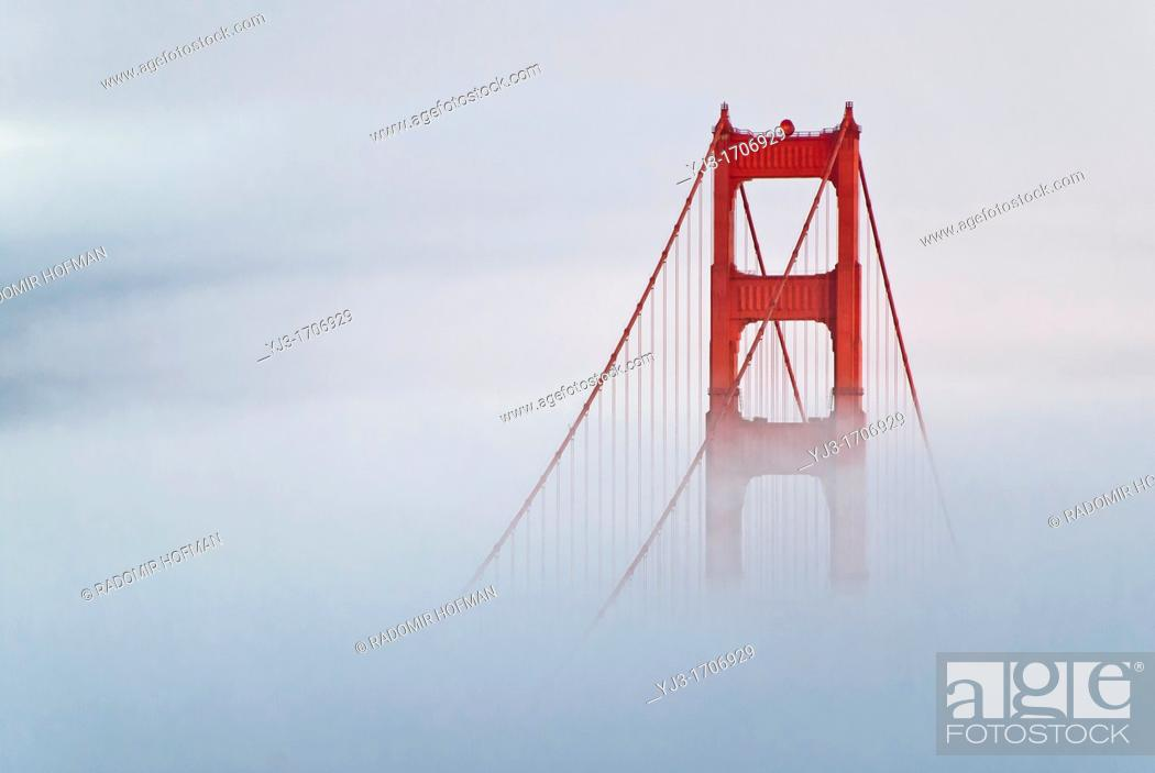 Stock Photo: Golden Gate Bridge-south tower coverd in fog, California, USA.