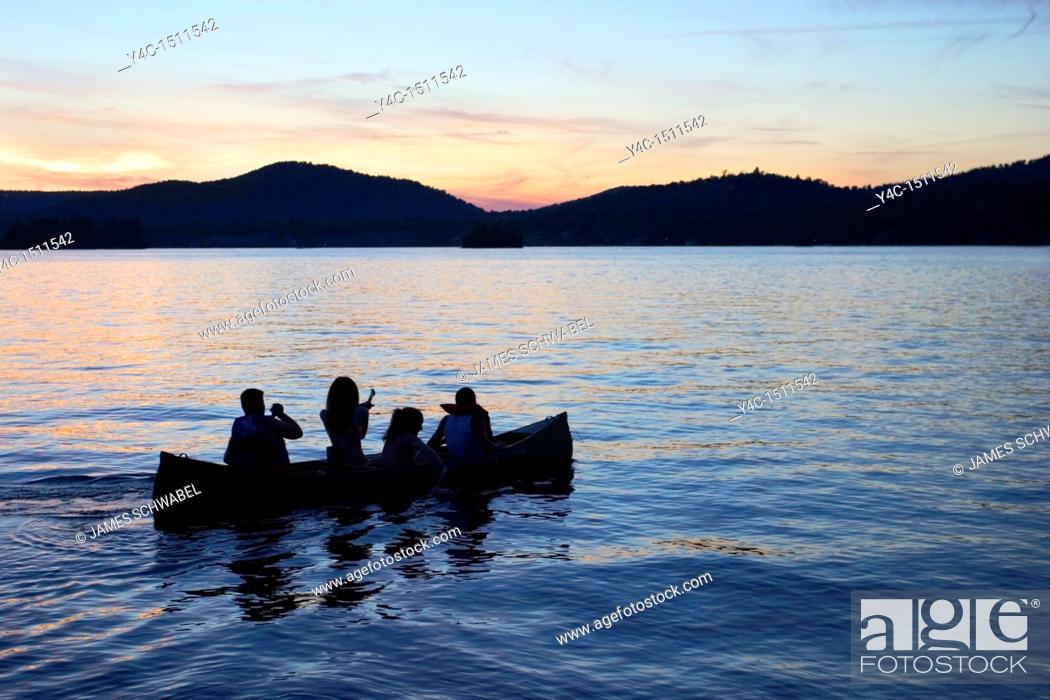 Stock Photo: Canoe on Fourth Lake at sunset, Inlet, New York, Adirondack Mountains.