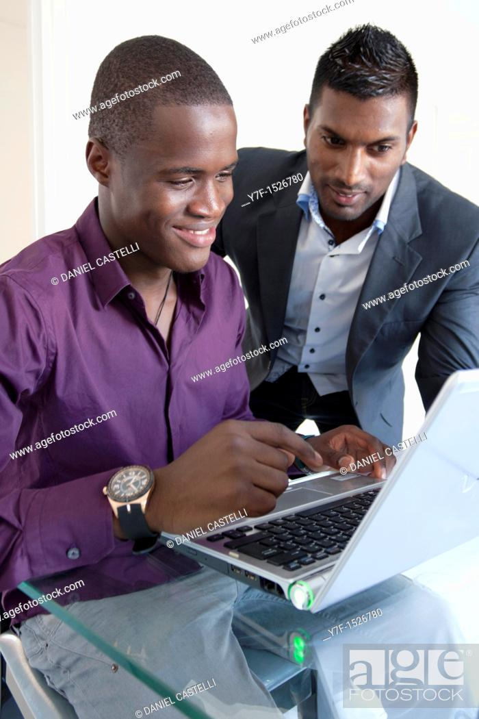 Stock Photo: Computing teacher and his young student.