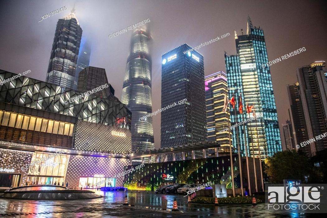 Stock Photo: The luminous skyline of Shanghai, China at night.