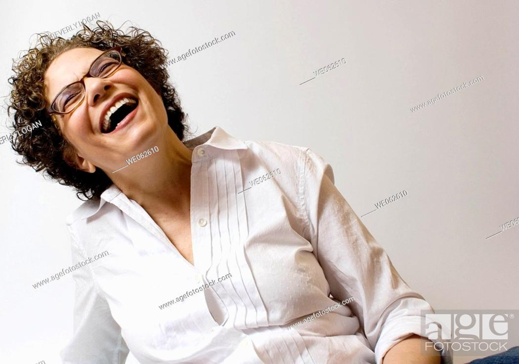 Stock Photo: Sixty-four-year old woman smiling.