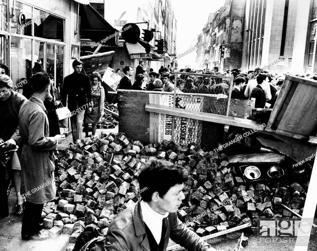 Stock Photo: PARIS STUDENT REVOLT, 1968.Barricade of paving stones and street lights in Rue des Saint-P�res on the Left Bank in Paris, France, May 1968.