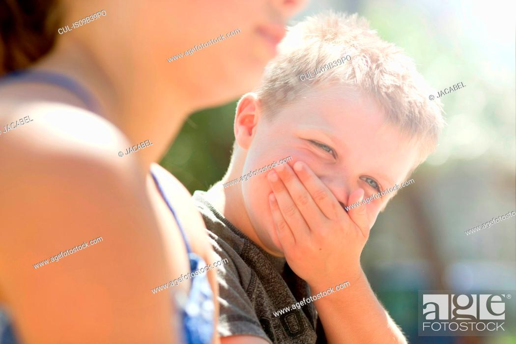 Stock Photo: Brother and sister laughing together.