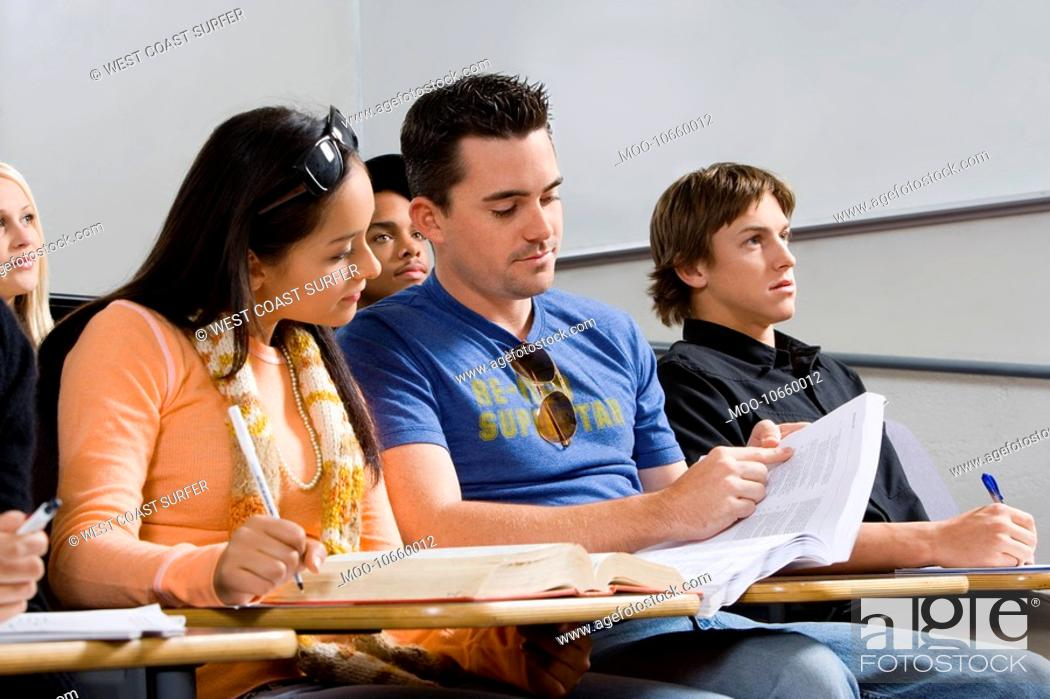 Stock Photo: Students studying in class.