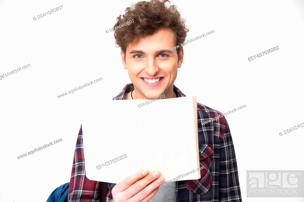 Stock Photo: Happy young male student holding blank notebook.