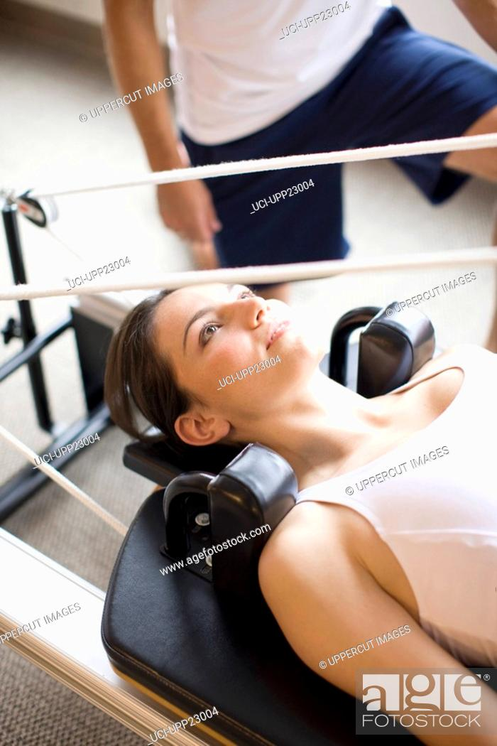 Stock Photo: Close up of woman on pilates equipment.