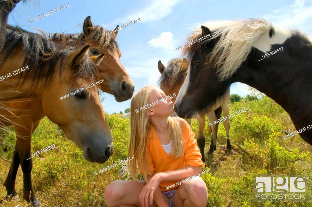 Stock Photo: Small girl in a pony herd.