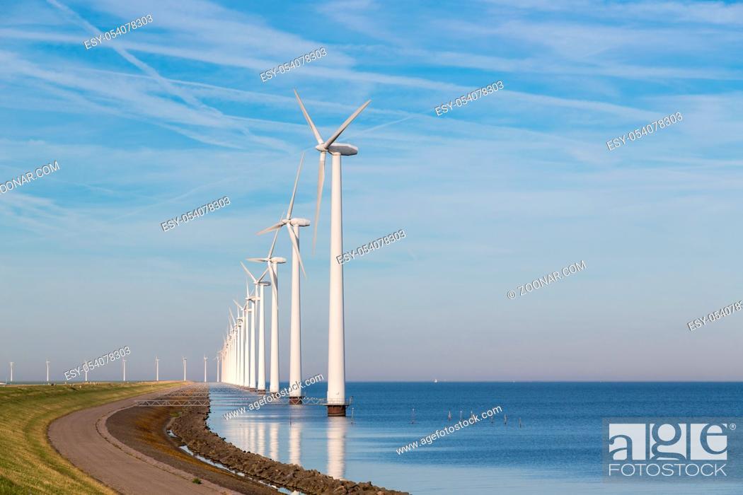Photo de stock: Long row off shore wind turbines along the Dutch coast.