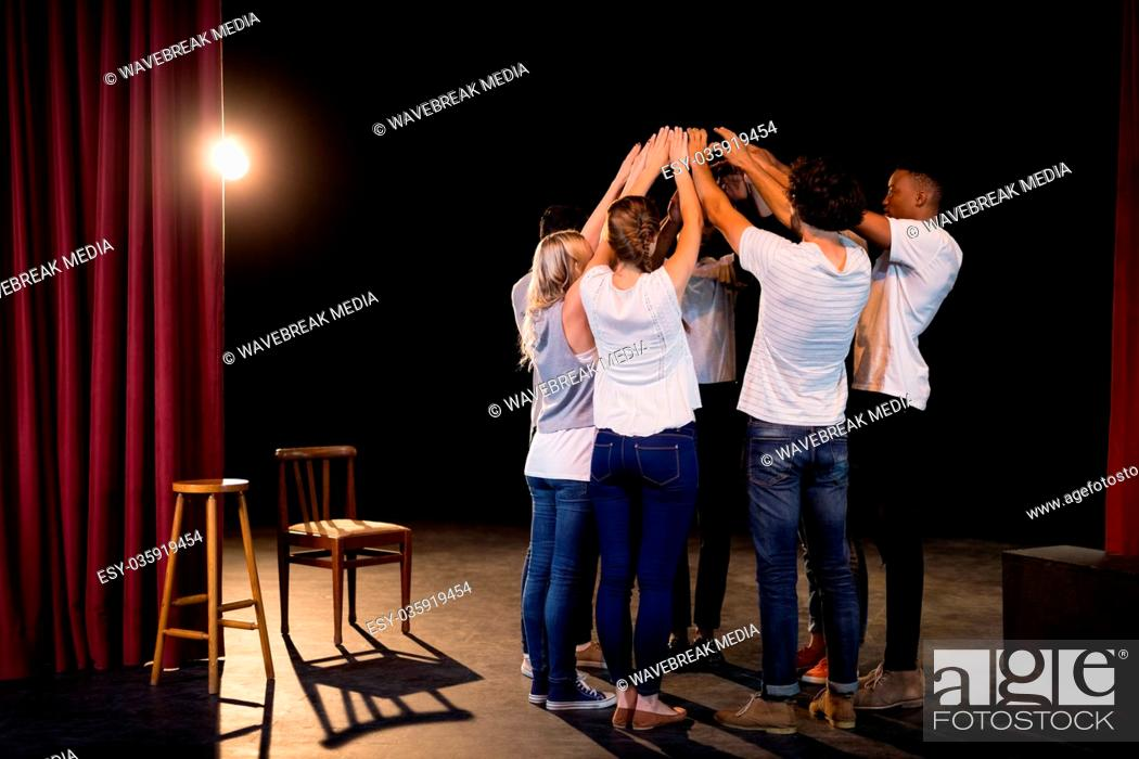 Photo de stock: Actors team forming their hands stacked.