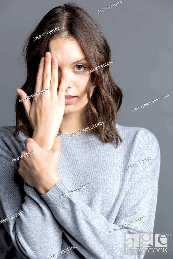 Stock Photo: Portrait of brunette young woman, obscured her eye.