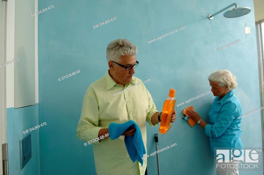 Stock Photo: Senior couple cleaning bathroom.