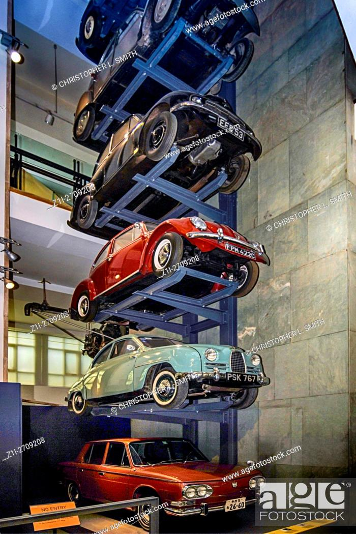 A display of 1950s vehicles stacked in a vertical car park invention ...