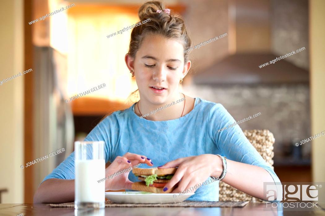 Stock Photo: Girl ready to eat sandwich.