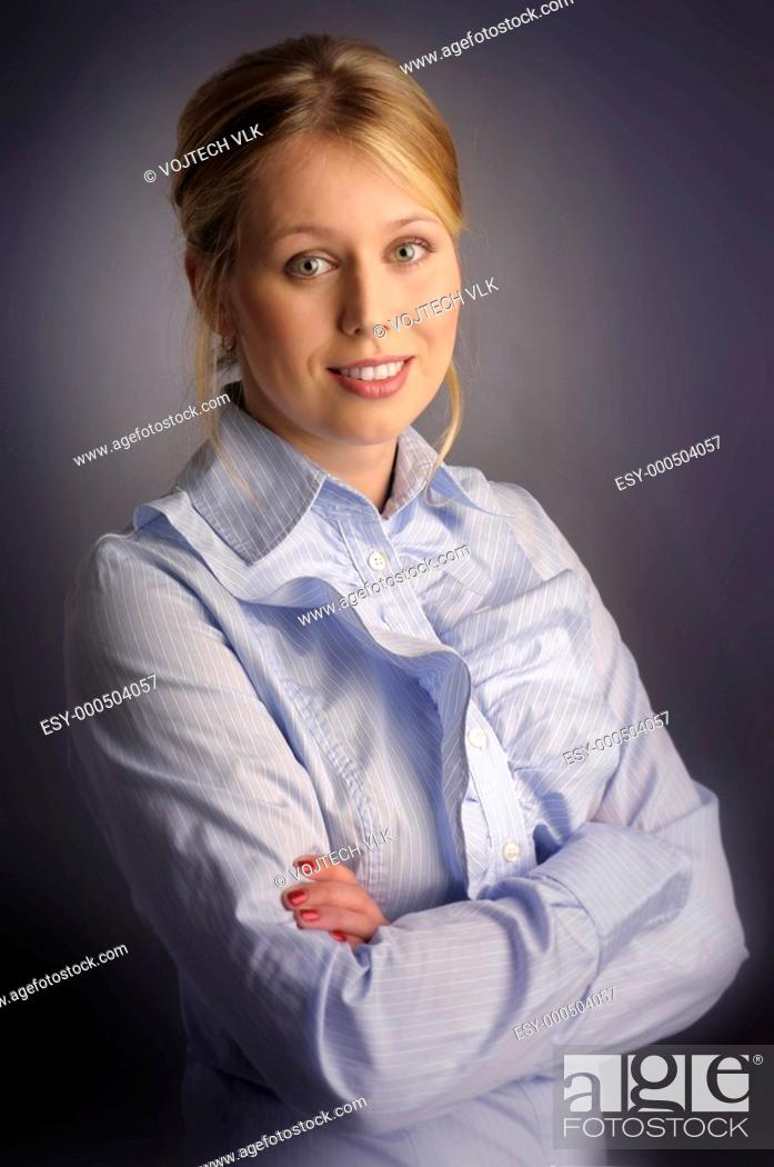 Stock Photo: The attractive woman in blue shirt.