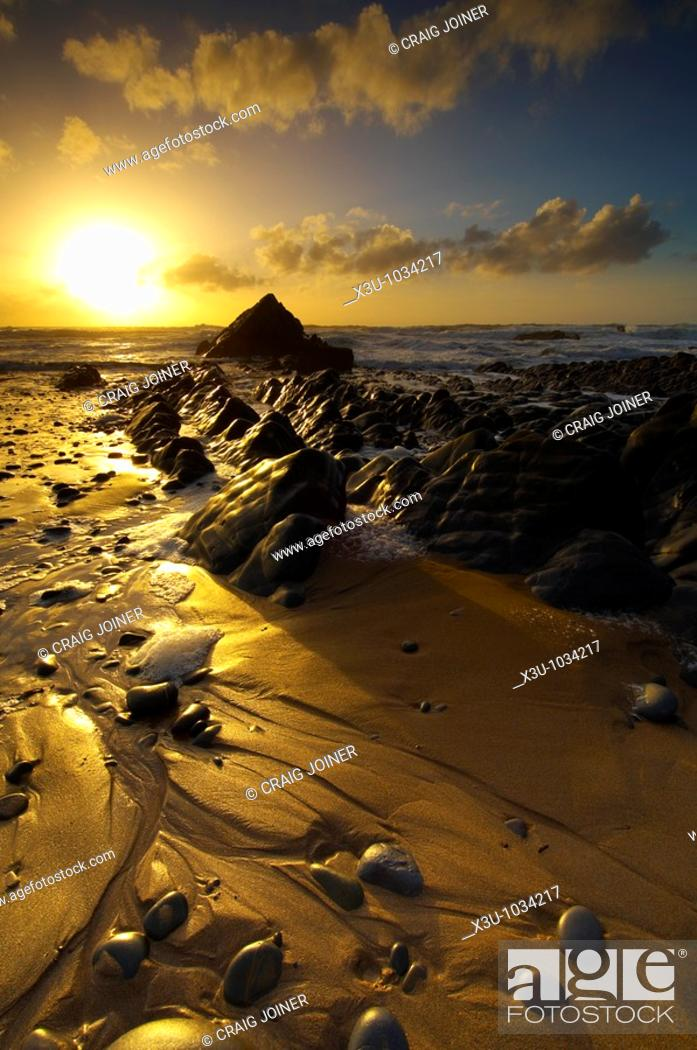Stock Photo: Sunset at Sandymouth in North Cornwall, England.