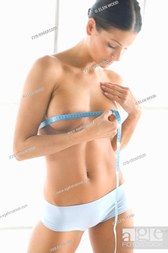 Stock Photo: woman measuring bust.