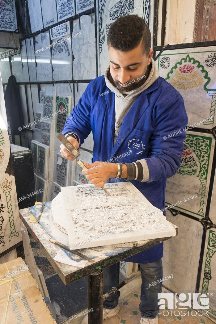 Stock Photo: A man carves the text on a limestone, tombstone in the old town of Fez, Morocco. Photo: André Maslennikov.