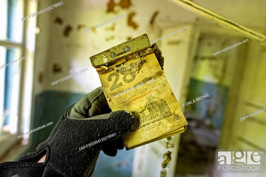 Stock Photo: The June 19, 2019, photo of an old calendar with the date of April 28 in abandoned territory in Ukraine nearby Chernobyl Nuclear Power Plant.