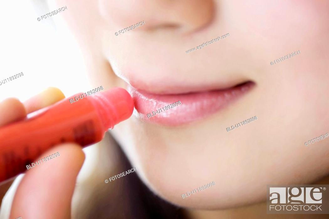 Stock Photo: Woman who rouge her lips.