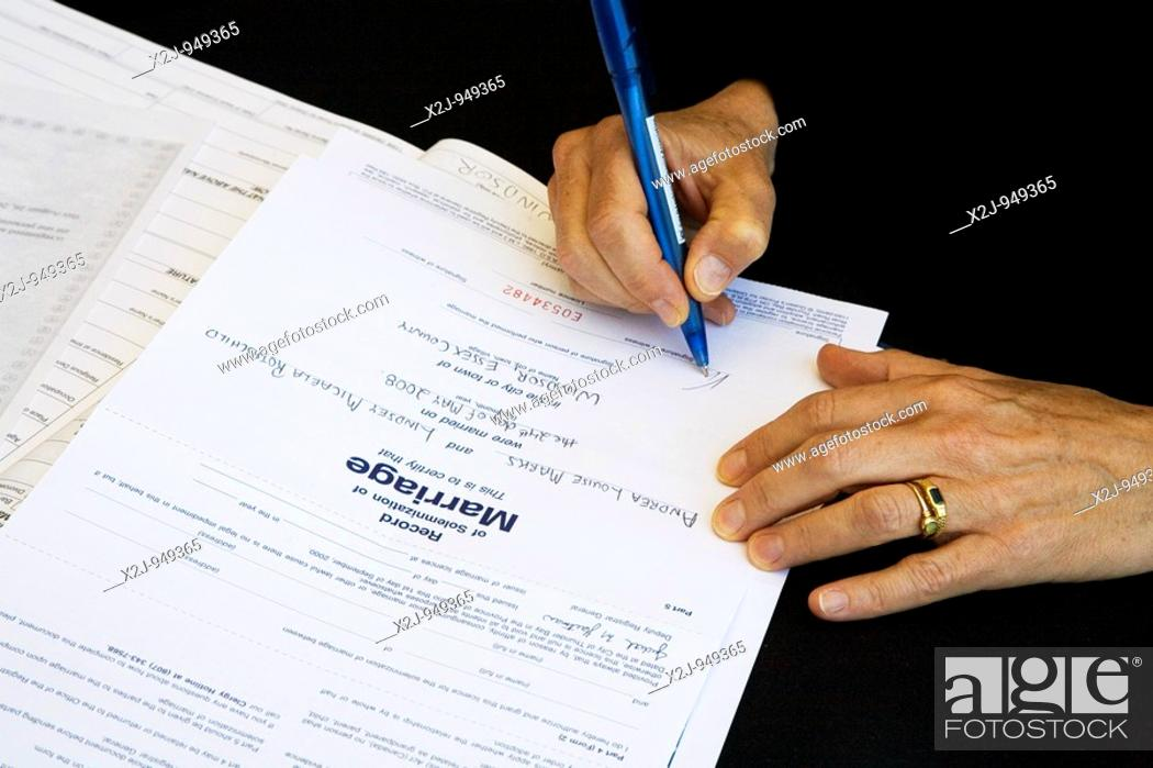 Windsor Ontario Canada A Witness Signs The Marriage Certificate