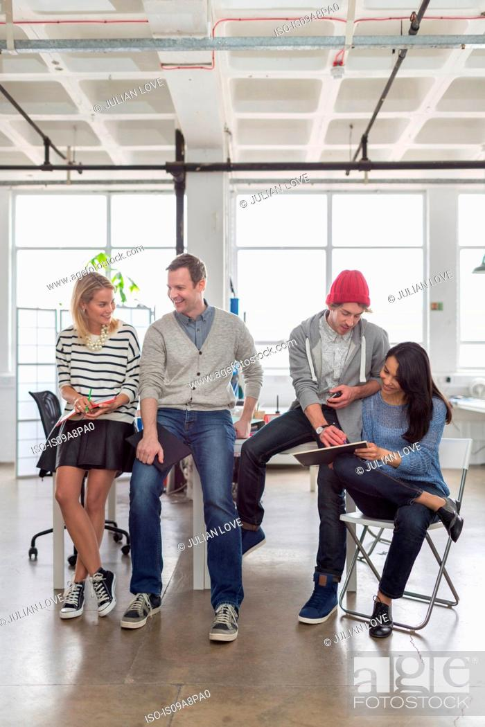 Stock Photo: Creative business team sitting together in office.