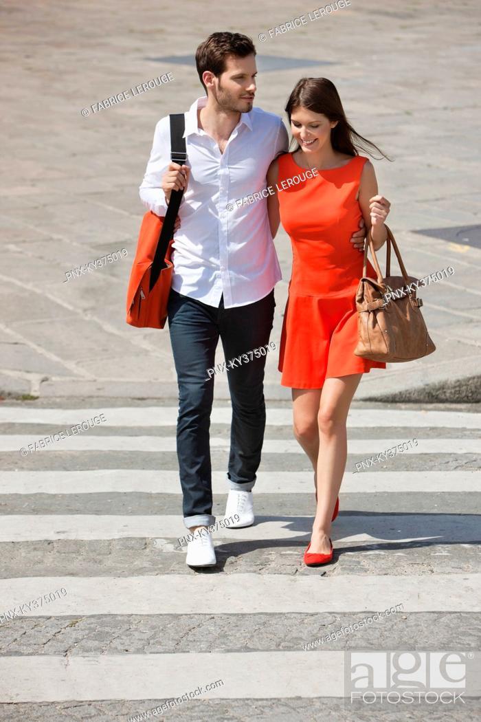 Stock Photo: Couple on a crosswalk, Paris, Ile-de-France, France.