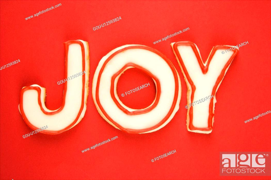 Stock Photo: Sugar cookies with decorative icing that spell joy.