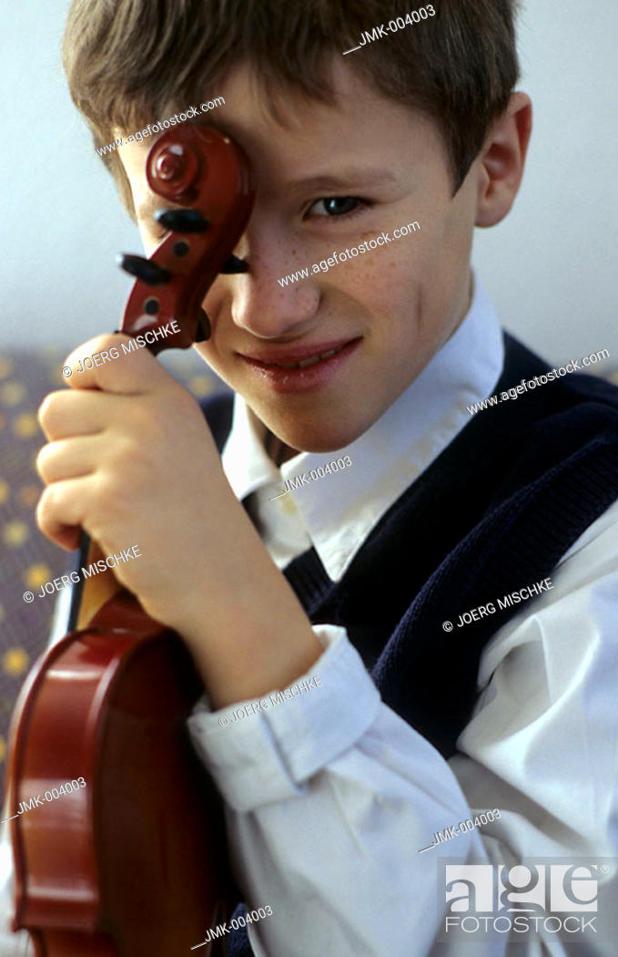 Stock Photo: A boy, 5-10 years old, holding a violin.
