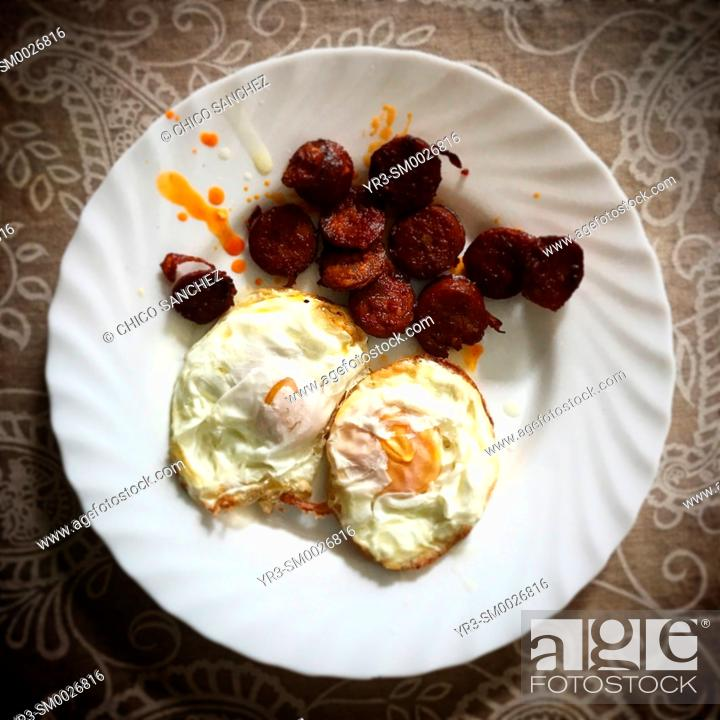 Stock Photo: Free range natural fried eggs and 'Pata Negra' Iberian pork sausages in a home in Prado del Rey, Sierra de Cadiz, Andalusia, Spain.