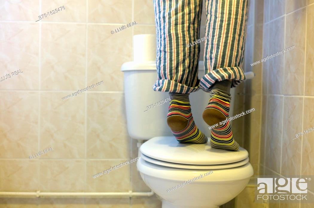 Photo de stock: Person standing on toilet.