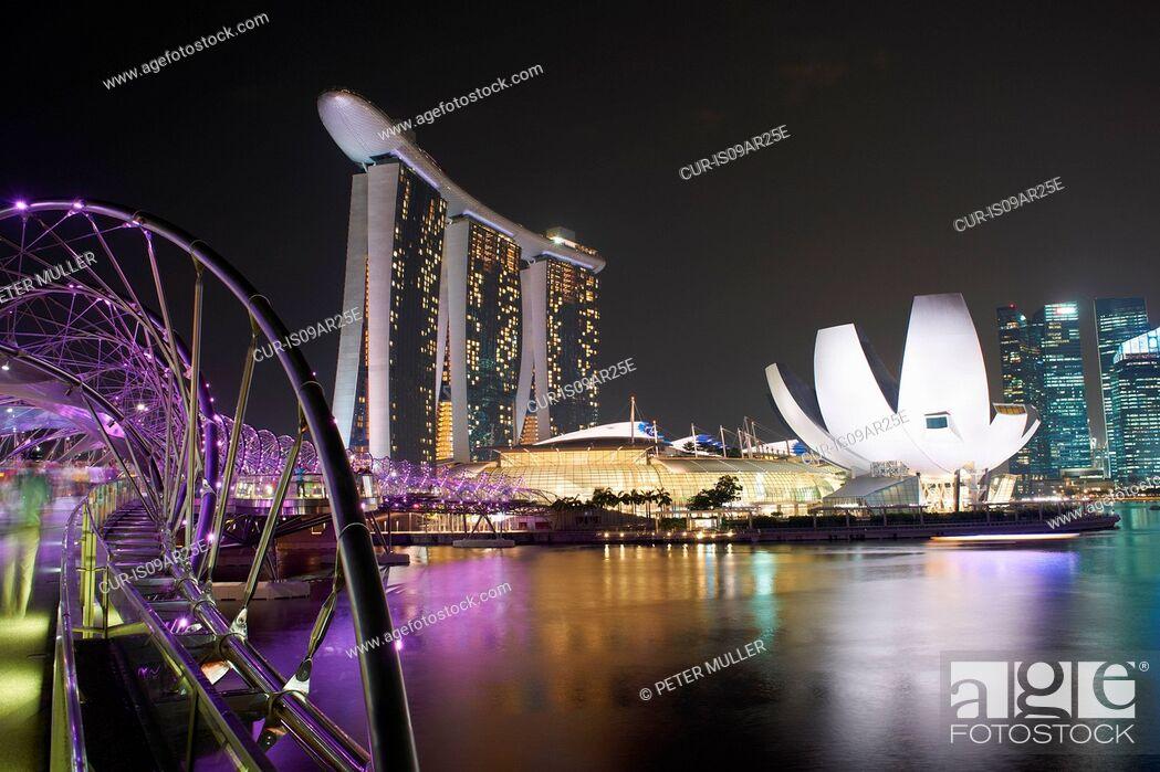 Stock Photo: Night view of helix bridge and marina sands bay hotel, Singapore.