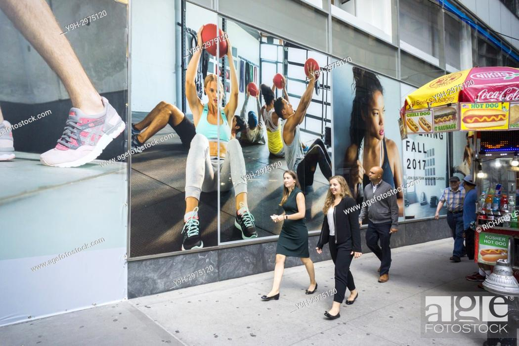 Stock Photo - Colorful photographs decorate the under construction Asics  store on Fifth Avenue in New York on Thursday b19fc5d2e866