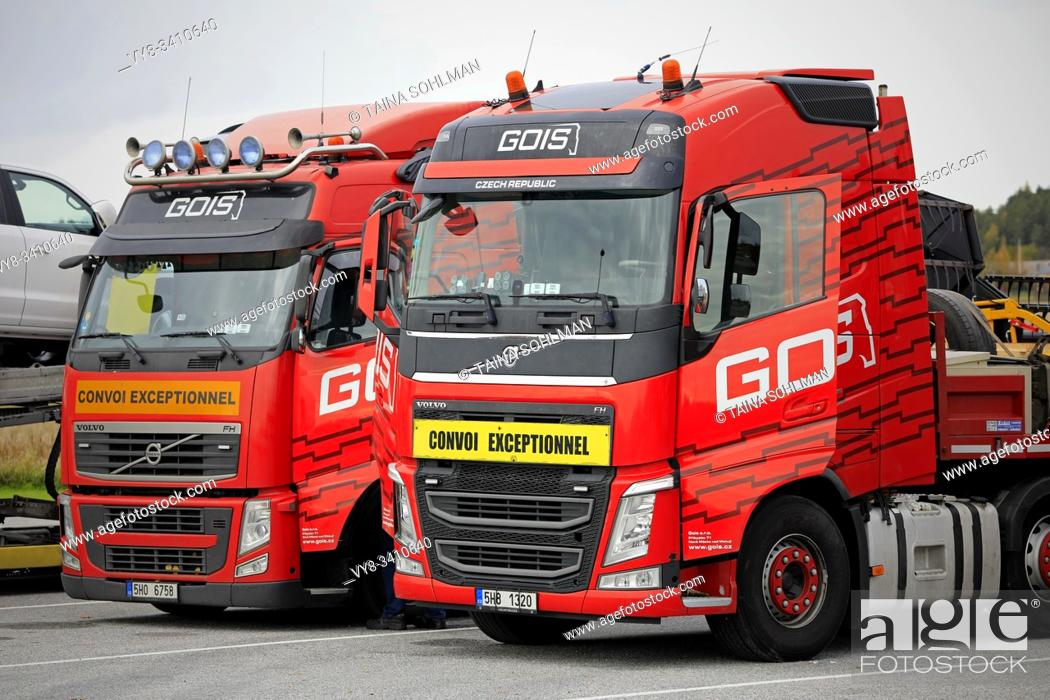 Stock Photo: Red Volvo FH semi trucks for oversized load transport of a Czech company Gois Logistics parked on a truck stop in Salo, Finland. October 6, 2019.