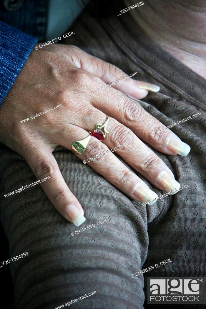 Stock Photo: Cuba, Cienfuegos  Long Fingernails Designate a Professional Woman, i e , one who does not dirty her hands while working.