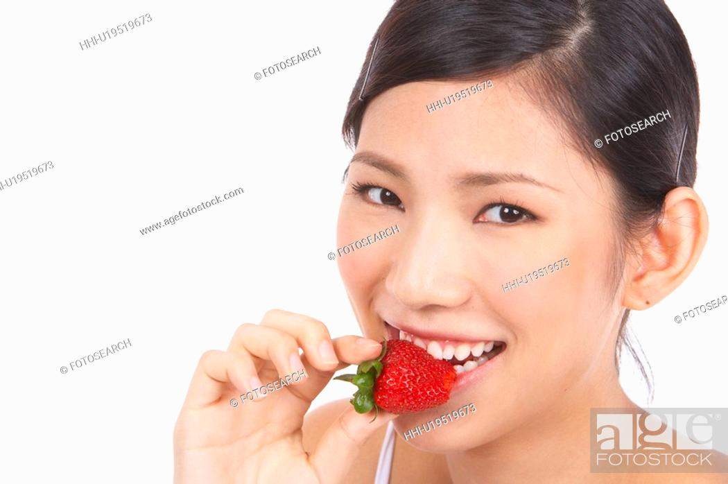 Stock Photo: Portrait of Natural Young girl eating Strawberry.