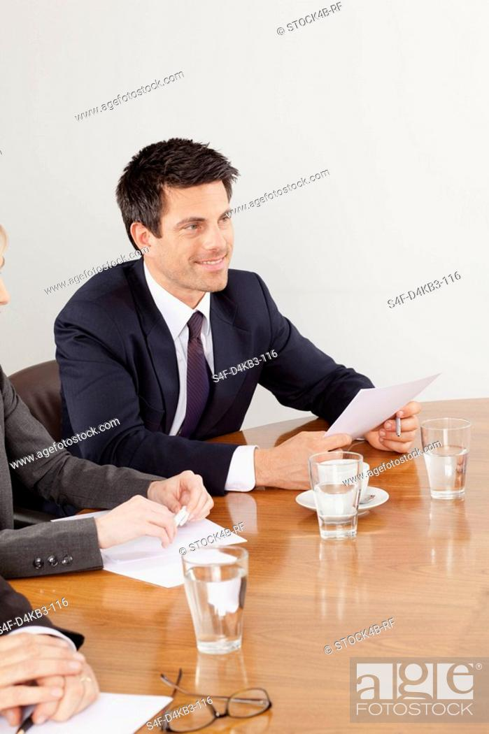 Stock Photo: Smiling businessman in conference room, Munich, Bavaria, Germany.