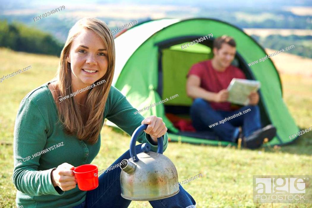 Stock Photo: Couple Making Hot Drink Whilst Camping In Countryside.