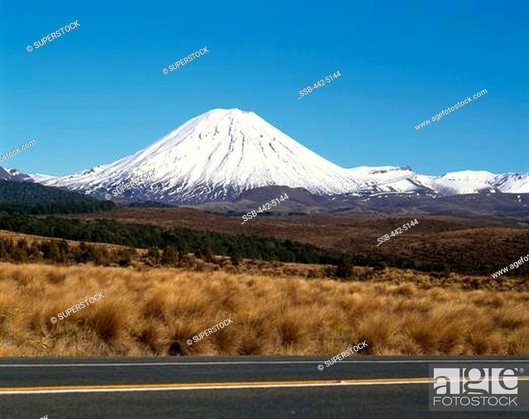 Stock Photo: Road running through a landscape, Mount Ngarahoe, Tongariro National Park, New Zealand.