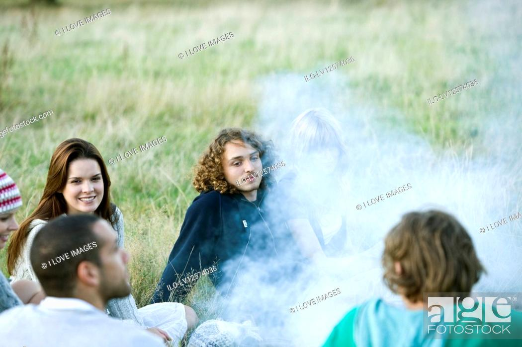 Stock Photo: A group of young friends having a barbecue.