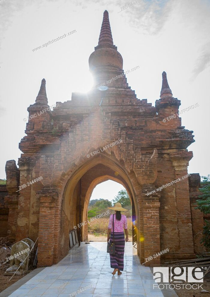 Stock Photo: Woman Going Out Of An Old Temple Gate, Bagan, Myanmar.