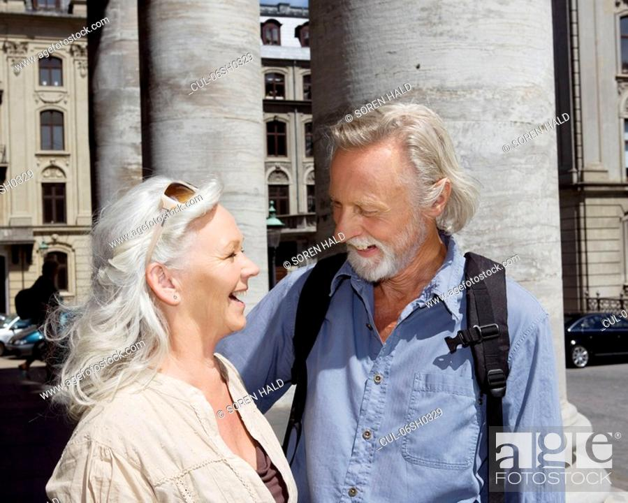 Stock Photo: Couple standing laughing.