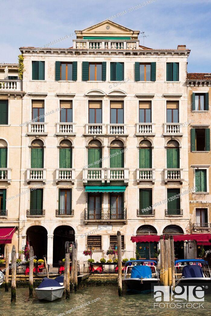 Stock Photo: Buildings along a canal, Venice, Veneto, Italy.