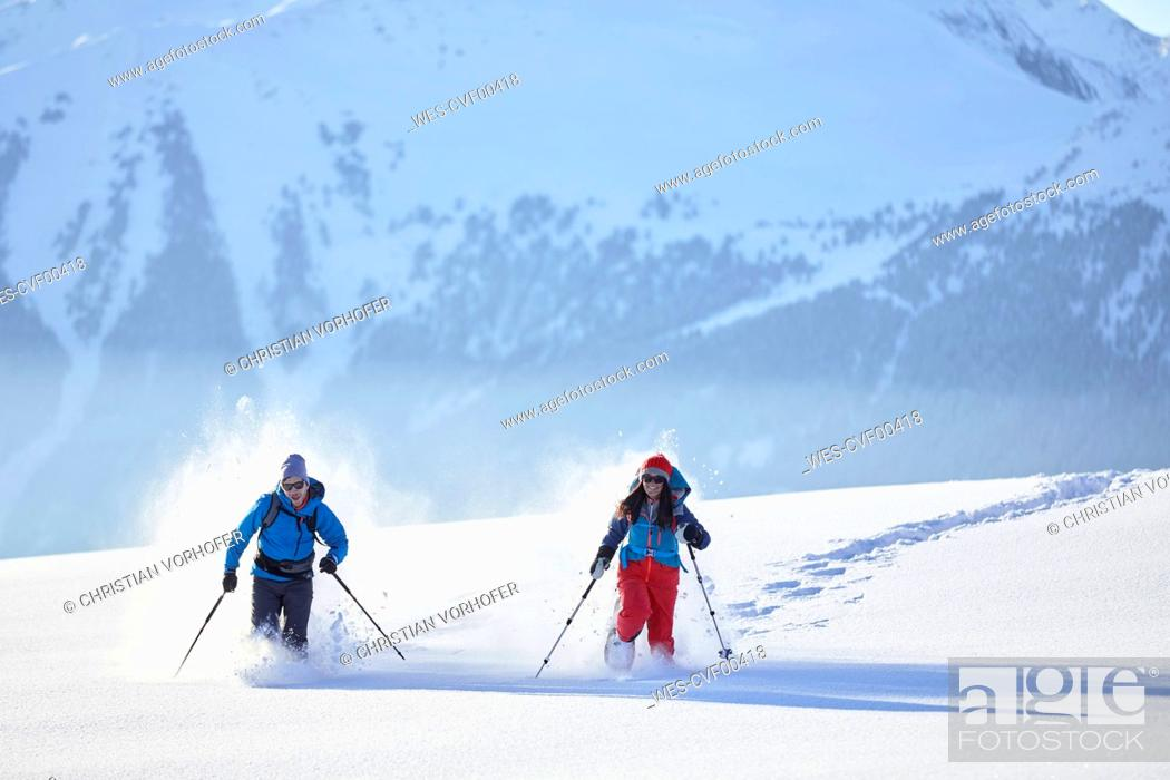Stock Photo: Austria, Tyrol, snowshoe hikers running through snow.