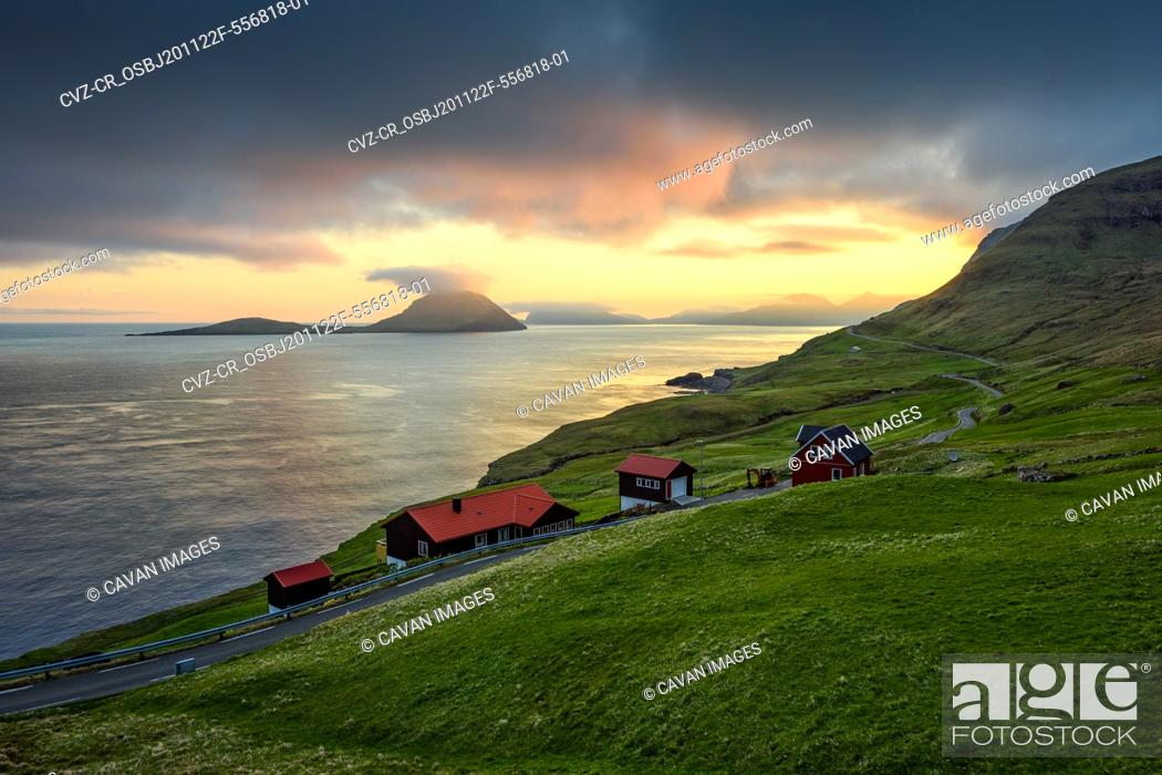 Stock Photo: Small settlement near sea at sunset.