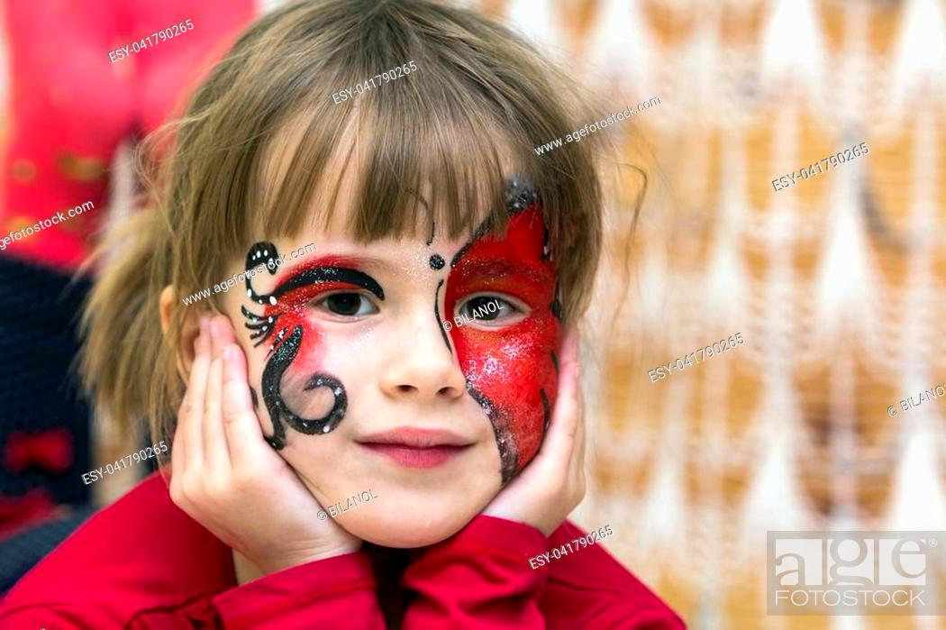Photo de stock: Portrait of pretty little girl with butterfly painting on her face.