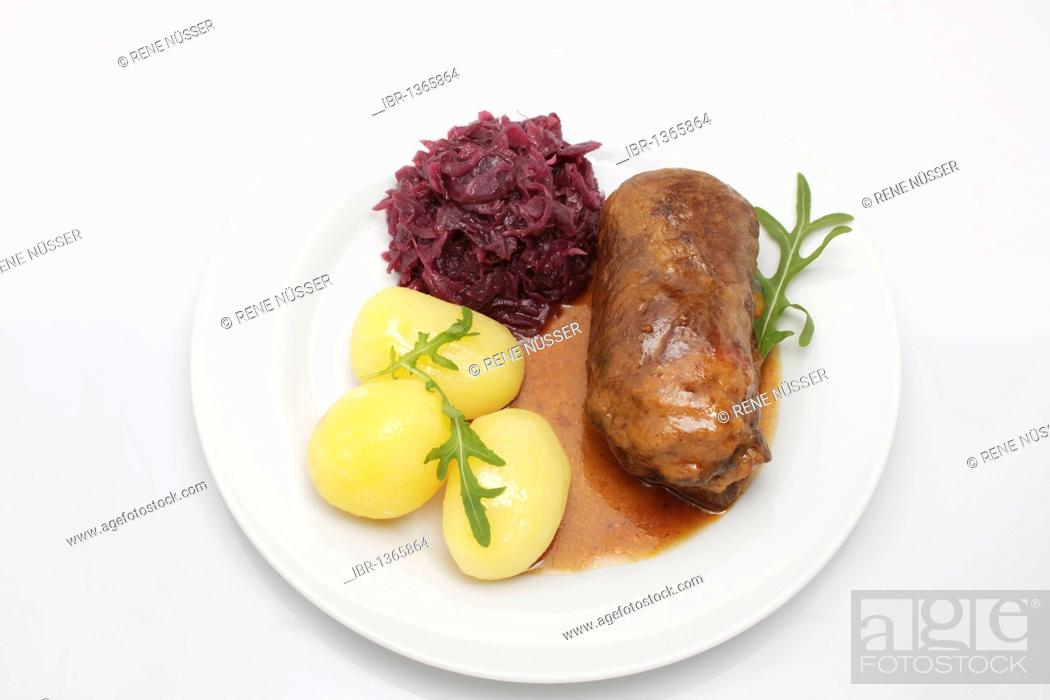 Stock Photo: Stuffed beef roulade with gravy, red cabbage and boiled potatoes.