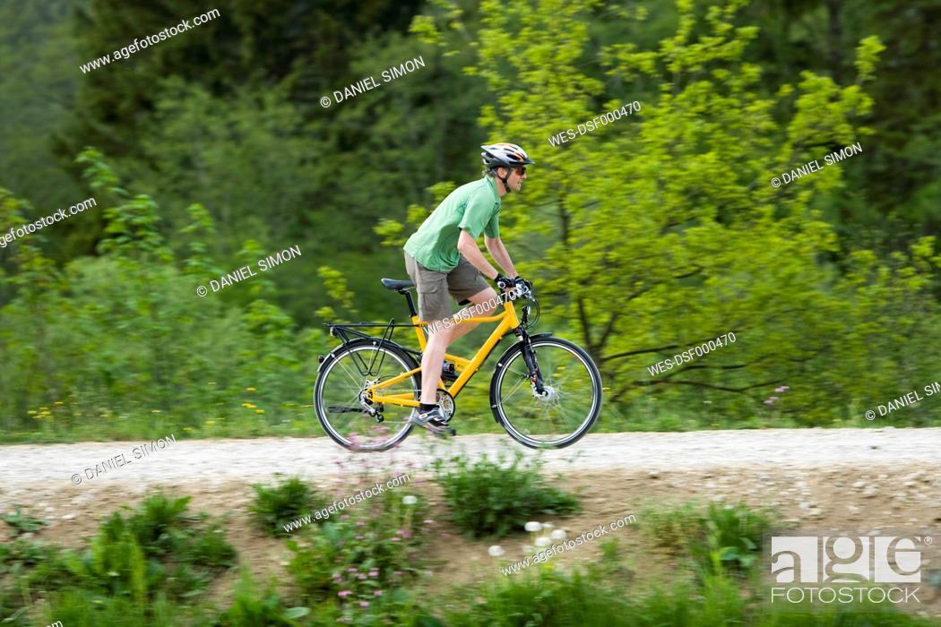Stock Photo: Germany, Bavaria, Munich, Mature man riding bicycle.