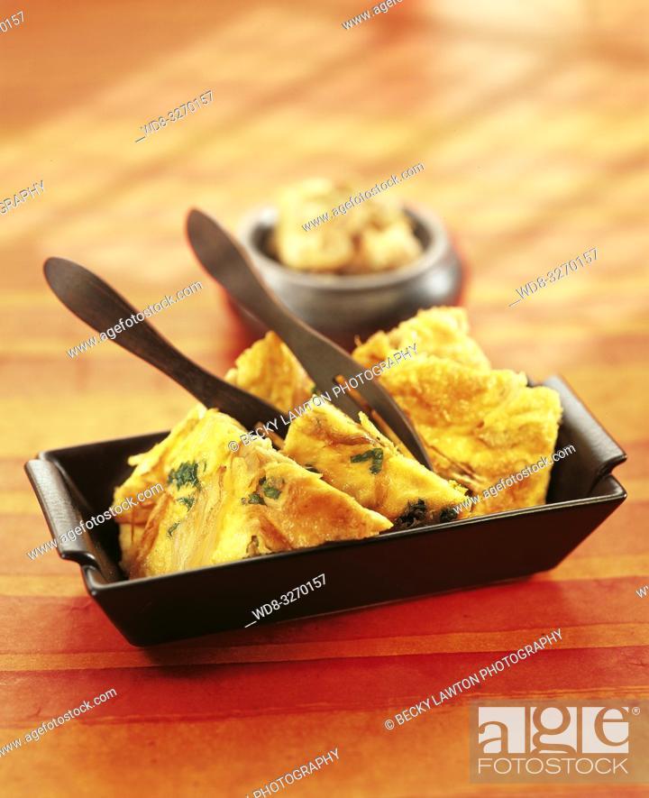 Imagen: tortilla de almejas y chalotas.
